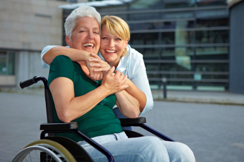 elder women smiling with her caregiver
